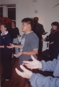a group of people practicing fragrant qigong techniques