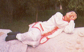 a person practicing sleeping qigong