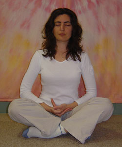 a person sitting in a 'lotus position'